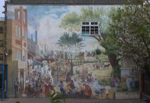 Mural by Claire Tomalin depicting an idealised River Fleet with Old St Pancras in the background, Mary and Percy Shelly tossing paper boats off a bridge.